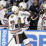 Blackhawks edge Lightning 2-1, reach brink of NHL title
