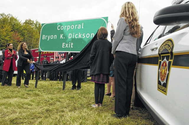 Interstate exit dedicated to memory of slain state trooper Cpl. Bryon Dickson