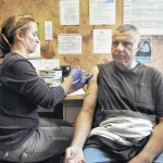 Taking a shot at good health; flu vaccination worth the pain