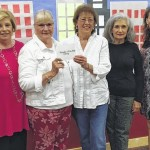 The GFWC presents proceeds to the Friends of the Hoyt Library
