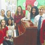 Students perform a piano recital at Keystone Gardens Estates