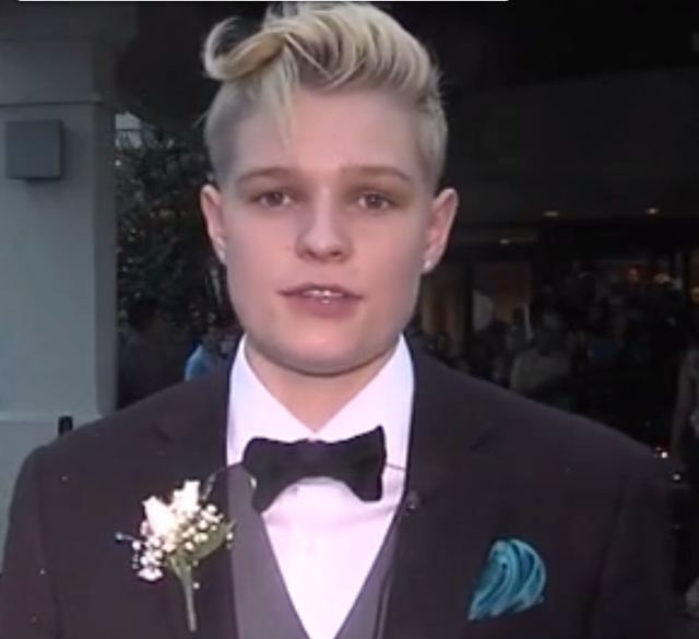Girl barred from prom for wearing suit gets invitation to another event