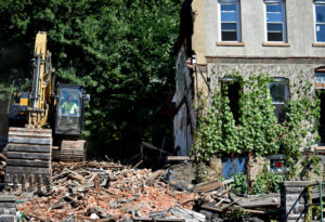 Contractor makes quick work razing condemned row homes in Wilkes-Barre