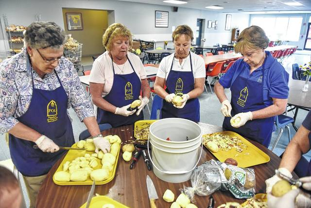 From Left: Irene Martin, Joan Kwarcinski, Claire Vassia And Barbara Ambrose  Cut Potatoes In Preparation For A Meal At The St. Vincent De Paul Kitchen  In ...
