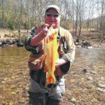 Kingston angler lands enormous golden rainbow trout in Benton